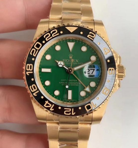 Rolex gmt full gold green dial